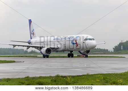 MOSCOW, RUSSIA - MAY 19, 2016: Airbus A321 Ural Airlines taxiing. Plane makes taxiing on taxiway Domodedovo International Airport.
