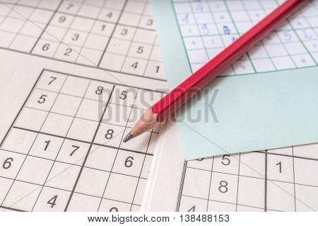 Close View On Pencil On Sudoku Crosswords. Popular Game With Num