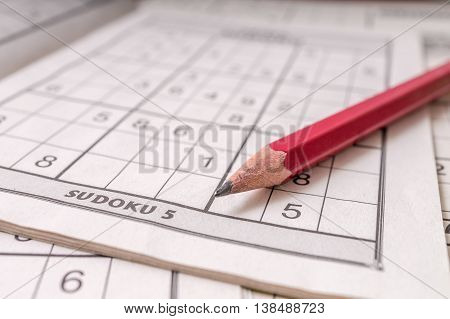 Close View On Pencil On Sudoku Crossword.
