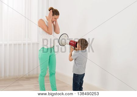 Boy Shouting At Her Mother Through Megaphone