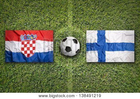 Croatia Vs. Finland Flags On Soccer Field