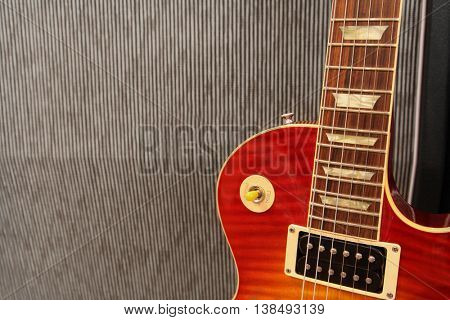 Electric Guitar leaning against an amplifier