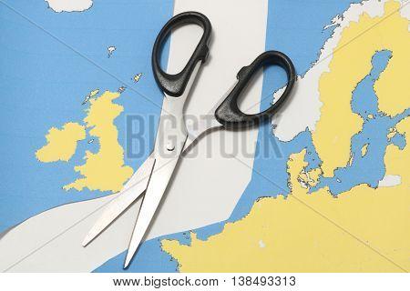 United Kingdom leaves European Union. Scissors cut the United Kingdom from EU. Brexit UK EU referendum concept.