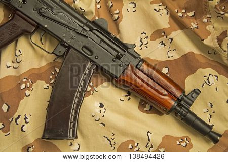 A Russian AKS-74U assault rifle, lying on US designed six-colour desert pattern camouflage, commonly known as chocolate chip.