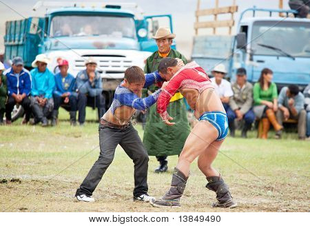 MOON SUM, MONGOLIA - JULY 25: traditional Mongolian fighting festival on July 25, 2010 in Moon Sum, Mongolia. Annual holiday in honor of town birthday.
