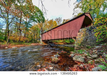 Jericho covered bridge in Autumn in Maryland over a stream