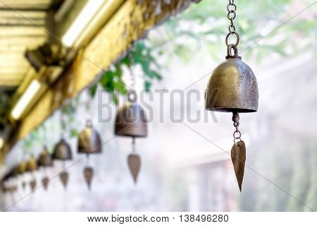 Bell ancient on the way of the Golden mount temple in Bangkok Thailand. Selective focus on the bell on the right.