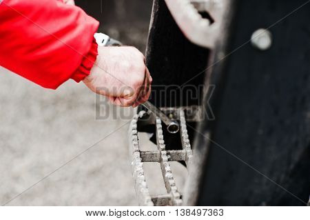 Mechanic Hand Hold Spanner Tool In Hand At Work
