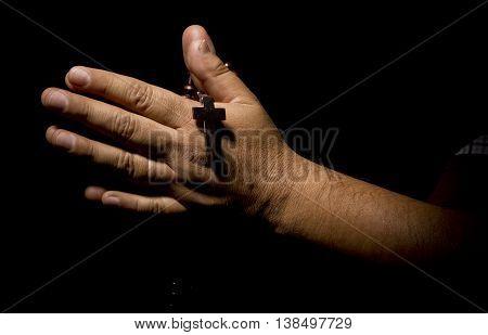 Praying Hands in black background christian church