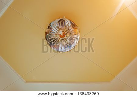 Golden And Mirror Chandelier With Point Light On Orange Ceiling