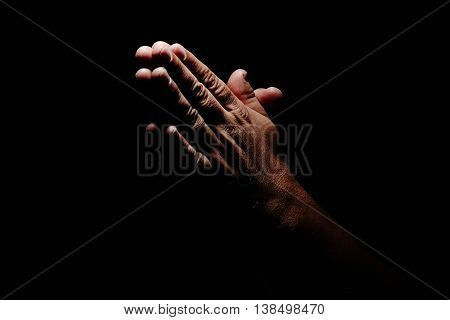 Praying Hands in black background inspirational life