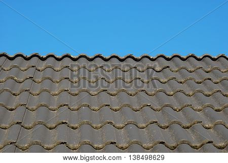 Gray roofing tiles background, home exterior with blue sky