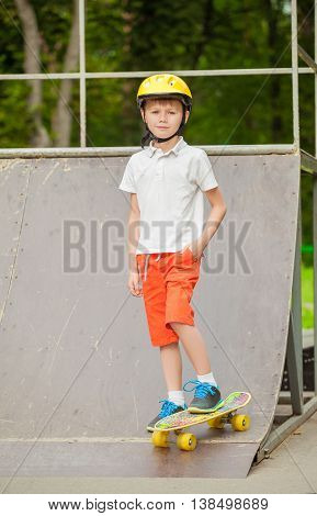 Boy in helmet standing on a skateboard