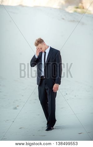 Portrait of young businessman on a sand quarry