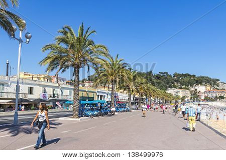 People Walk On Promenade Des Anglais In Nice, France