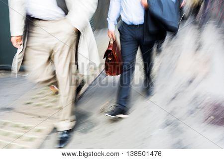 Businessmen Walking In The City