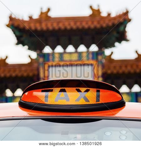 Taxi Sign Of A London Taxi In Front Of The Chinatown Gate In London