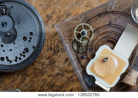 Components Of A Clock On A Watchmakers Workbench