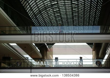 BERLIN, GERMANY - JUNE 21: Guests and visitors go over two bridges with Glass railings in the Mall of Berlin on June 21, 2016 in Berlin.