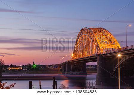 Beautiful Waal Bridge at sunset twilight background