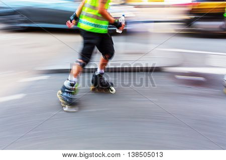 rollerblader on a city street in motion blur