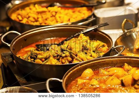 Pans With Vegetable Stew At A Food Market