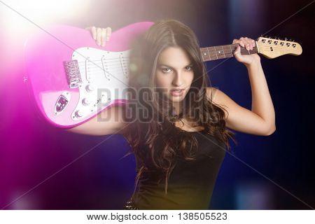 Rock star girl holding guitar