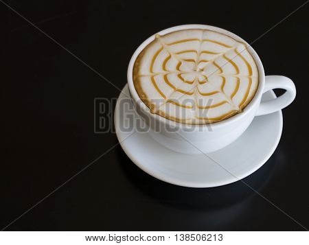 Coffee cup  on wooden table on back background