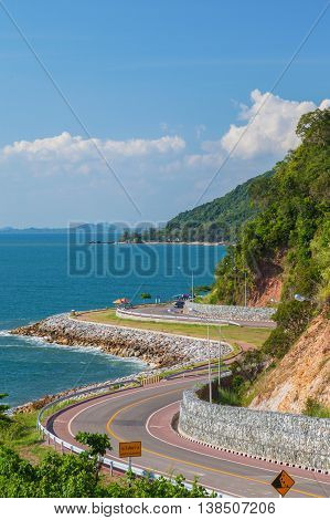 Scenic road beside deep blue sea and blue sky