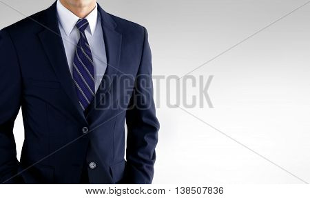 Man standing in business suit over white