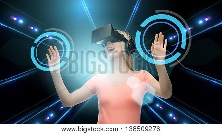 technology, virtual reality, cyberspace and people concept - happy young woman with virtual reality headset or 3d glasses touching screen projection over black background and laser light