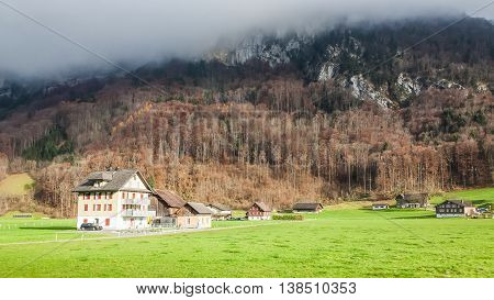 Holiday in Switzerland - Beautiful foggy view of winter landscape towards Engelberg, Switzerland