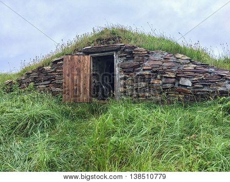 Root Cellar with Open Door in Newfoundland
