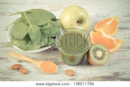 Vintage Photo, Ingredients And Fresh Cocktail From Spinach On Wooden Background, Healthy Nutrition