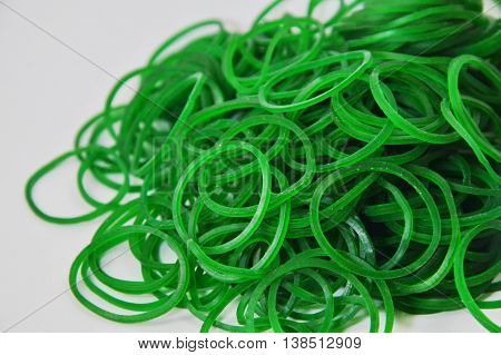 green elastic band on the white background