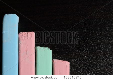 Chalk for drawing. Multi-colored chalk. Different colors.  Green red and blue. It lies in a staggered schedule.