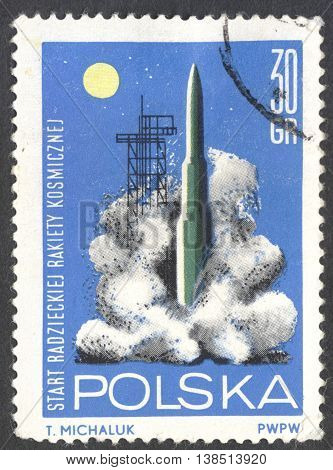 MOSCOW RUSSIA - CIRCA JANUARY 2016: a post stamp printed in POLAND shows launching of the Russian rocket the series