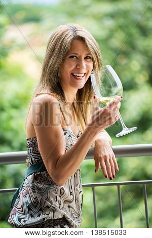 Happy Woman Drinking Wine And Celebrating