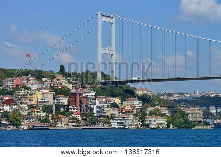 ISTANBUL - AUGUST 8: transport on and under Ataturk Bridge (Bosphorus Bridge), August 8, 2013 in Istanbul, Turkey. Ataturk Bridge is a first suspension bridge over the Bosphorus Strait.