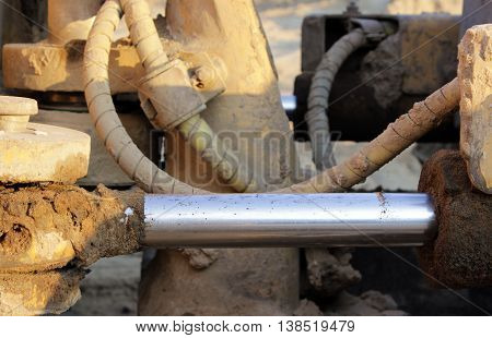 hydraulic hoses on a piston against the hydraulic system in the bulldozer