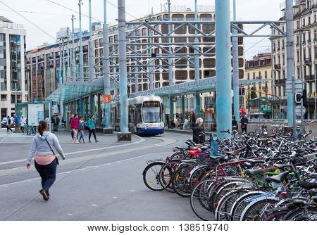 Geneva Switzerland - June 17 2016: The city tram and bicycles on street in Geneva