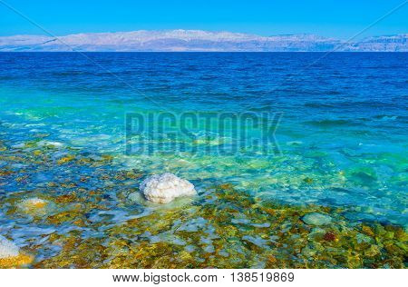 The Dead Sea that is the deepest hypersaline lake in the world boasts clear water Ein Gedi Israel.