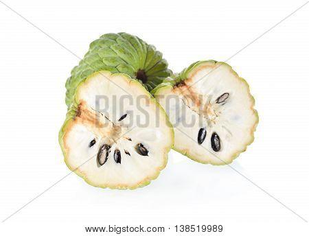 whole and half cut custard apple fruit on white background
