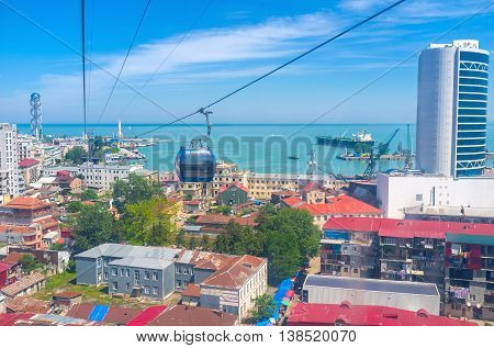 The blue lift of the cableway rides over the roofs of Batumi Georgia.