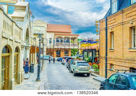 TBILISI GEORGIA - MAY 28 2016: The narrow tourist street with the cozy cafes small hotels and guest houses located at the foot of Sololaki Hill on May 28 in Tbilisi.