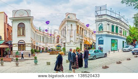 TBILISI GEORGIA - MAY 28 2016: The interesting winding buildings separate area into the narrow twisted streets full of the cozy cafes and luxury restaurants on May 28 in Tbilisi.