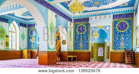 TBILISI GEORGIA - MAY 28 2016: The interior of Jumah (Friday) Mosque decorated with arabic inscriptions from Quran and floral ornaments in blue gamma on May 28 in Tbilisi.