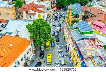 TBILISI GEORGIA - MAY 28 2016: The view from the cable car on the old town colorful roofs and traffic jam in the twisted street on May 28 in Tbilisi.