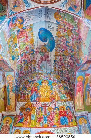 TBILISI GEORGIA - MAY 28 2016: The interior of Upper Bethlehem Church decorated with colorful frescoes depicting the scenes from the Holy Bible on May 28 in Tbilisi.