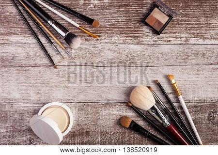 Cosmetics And Make-up Products On Wooden Table